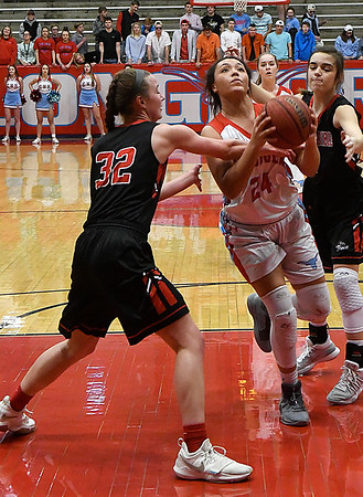 Chisholm's Tatum Long is fouled by Oklahoma Bible Academy's Sage Kroeker Monday January 29, 2018 at Chisholm High School. (Billy Hefton / Enid News & Eagle)