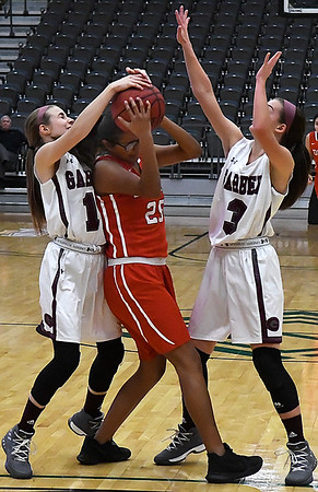 Garber's Paige Frickenschmidt and Kathyn Plunkett trap Dover's Jackie Rodriguez during an opening round game of the 94th Annual Skeltur Conference Basketball Tournament Monday January 15, 2018 at the Central National Bank Center. (Billy Hefton / Enid News & Eagle)