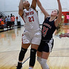 NOC Enid's Tanara Combs puts up a shot against Seminole State's Hannah Ash Thursday January 25, 2018. (Billy Hefton / Enid News & Eagle)