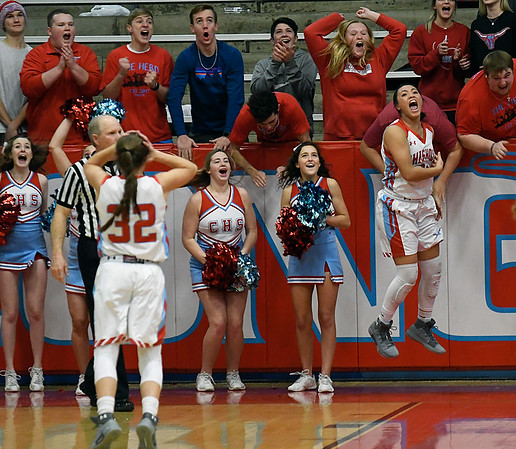 Chisholm's Tatum Long (right) celebrates after scoring the game winning basket as time expired against Alva during the opening round of the 48th Annual Wheat Capital Basketball Tournament Thursday January 4, 2018 at Chisholm High School. (Billy Hefton / Enid News & Eagle)