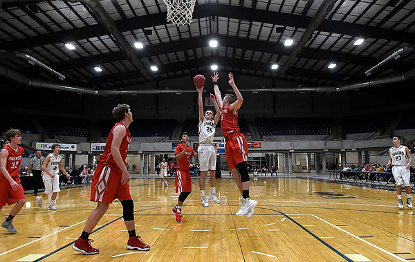 Timberlakes's Xaylen Stearns shoots over Ringwood's Camden Patterson during the championship game of the Cherokee Strip Basketball Tournament Saturday January 20, 2018 at the Chisholm Trail Expo Center. (Billy Hefton / Enid News & Eagle)