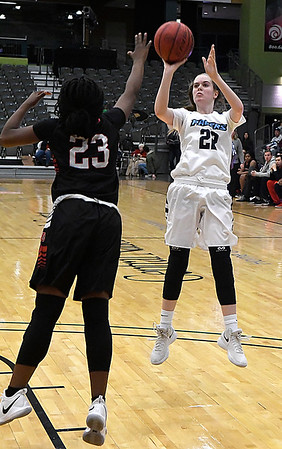 Enid's Cayti Moeller shoots over of Del City's Ariya Smithers Friday January 12, 2018 at the Central National Bank Center. (Billy Hefton / Enid News & Eagle)