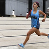 Enid's Genesis Carrillo runs the third leg of the 4 x 800 relay Friday January 26, 2018 at the Chisholm Trail Expo Center. (Enid News & Eagle)