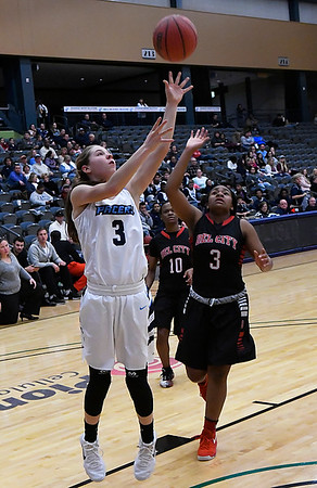 Enid's Ashley Handing puts up a shot in front of Del City's Laderia Lorne Friday January 12, 2018 at the Central National Bank Center. (Billy Hefton / Enid News & Eagle)