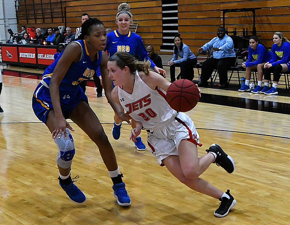 NOC Enid's Andi Pierce drives the baseline against NEO's Mariam Gnanou Monday January 22, 2018 at the NOC Mabee Center. (Billy Hefton / Enid News & Eagle)