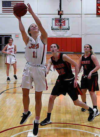 NOC Enid's McKenna Pulley scores against Mid American Christian University JV Tuesday January 9, 2018 at the NOC Mabee Center. (Billy Hefton / Enid News & Eagle)