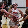 NOC Enid's Andi Pierce drives to the basket between Mid American Christian University JV defenders Tuesday January 9, 2018 at the NOC Mabee Center. (Billy Hefton / Enid News & Eagle)