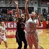 Kingfisher's Katelyn Stolz puts up a shot against Fairview's Maddie Mason during the semi finals of the 49th Wheat Capital Basketball Tournament Friday January 5, 2018 at Chisholm High School. (Billy Hefton / Enid News & Eagle)
