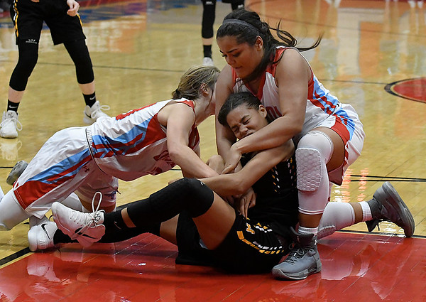 Chisholm's Briley Yunker and Lucy Raynor ties up Alva's Rianna Clark during the opening round of the 48th Annual Wheat Capital Basketball Tournament Thursday January 4, 2018 at Chisholm High School. (Billy Hefton / Enid News & Eagle)