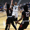 Enid's Breeasha Shaver shoots over Del City's Eriyahn Patterson Friday January 12, 2018 at the Central National Bank Center. (Billy Hefton / Enid News & Eagle)