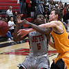NOC Enid's Dyaire Holt is fouled by NEO's Kyle Lukasiewicz Monday January 22, 2018 at the NOC Mabee Center. (Billy Hefton / Enid News & Eagle)