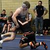 Enid's Augie Pritchett wrestles Putnam City's Tomas Santana Tuesday January 9, 2018 at Waller Middle School. (Billy Hefton / Enid News & Eagle)