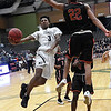Enid's Jerra Williams tries to go atound and under Del City's Nathaniel Goodlow Friday January 12, 2018 at the Central National Bank Center. (Billy Hefton / Enid News & Eagle)