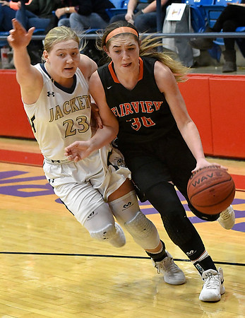 Fairview's Maddie Mason drives toward the basket against Kingfisher's Katelyn Stolz during the semi finals of the 49th Wheat Capital Basketball Tournament Friday January 5, 2018 at Chisholm High School. (Billy Hefton / Enid News & Eagle)