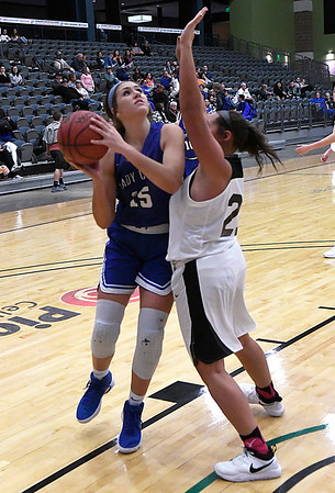 Covington-Douglas' Courtney McDonald shoots over Pond Creek-Hunter's Netanya Fetters during the third place game in the 94th Annual Skeltur Conference Basketball Tournament Friday January 19, 2018 at the Central National Bank Center. (Billy Hefton / Enid News & Eagle)