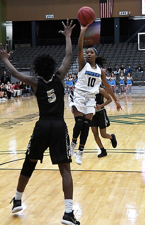 Enid's Breeasha Shaver shoots over Midwest City's Dajahnair Chatman Friday January 26, 2018 at the Central National Bank Center. (Billy Hefton / Enid News & Eagle)