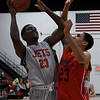 NOC Enid's Bryshon Bryant puts up a shot against Seminole State's Aaron Givens Thursday January 25, 2018 at the NOC Mabee Center. (Billy Hefton / Enid News & Eagle)