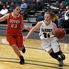 Garber's Emily Myers drives around Dover's Paige Collins during an opening round game of the 94th Annual Skeltur Conference Basketball Tournament Monday January 15, 2018 at the Central National Bank Center. (Billy Hefton / Enid News & Eagle)