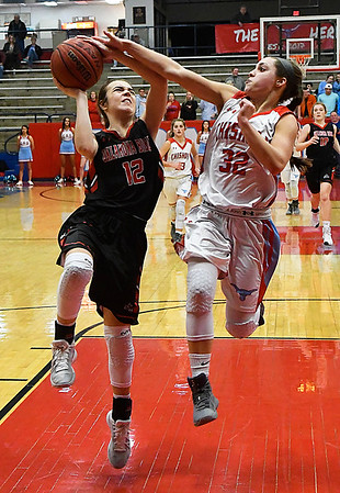 Chisholm's Tatum Sefcik defends a shot by Oklahoma Bible Academy's Devan Hawk Monday January 29, 2018 at Chisholm High School. (Billy Hefton / Enid News & Eagle)