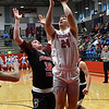 Chisholm's Noah Hann shoots over Oklahoma Bible Academy's Montel Meyer Monday January 29, 2018 at Chisholm High School. (Billy Hefton / Enid News & Eagle)