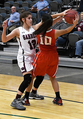 Garber's Bailey Miller pressures Dover's Yazaret Gamez during an opening round game of the 94th Annual Skeltur Conference Basketball Tournament Monday January 15, 2018 at the Central National Bank Center. (Billy Hefton / Enid News & Eagle)