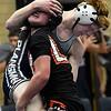 Enid's Braden Scott wrestles Putnam City's Caleb Hukill Tuesday January 9, 2018 at Waller Middle School. (Billy Hefton / Enid News & Eagle)
