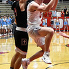 Chisholm's Kolten Childers is fouled by Oklahoma Bible Academy's William Price Monday January 29, 2018 at Chisholm High School. (Billy Hefton / Enid News & Eagle)