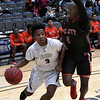 Enid's Jerra Williams drives towards the basket against Del City's Issac Beverly Friday January 12, 2018 at the Central National Bank Center. (Billy Hefton / Enid News & Eagle)
