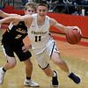 Kingfisher's Jett Sternberger dribbles around Alva's Jacob Faulkner during the semi finals of the 49th Wheat Capital Basketball Tournament Friday January 5, 2018 at Chisholm High School. (Billy Hefton / Enid News & Eagle)