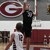 Pond Creek-Hunter's Mason Hart shoots over Garber's Dayne Fuxa Tuesday January 23, 2018 at Garber High School. (Billy Hefton / Enid News & Eagle)
