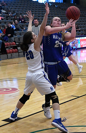 Waukomis' Taylor Moody puts up a shot against Covington-Douglas' Jaelyn Groves Thursday January 18, 2018 during a semi final game of the 94th Annual Skeltur Conference Basketball Tournament at the Central National Bank Center. (Billy Hefton / Enid News & Eagle)