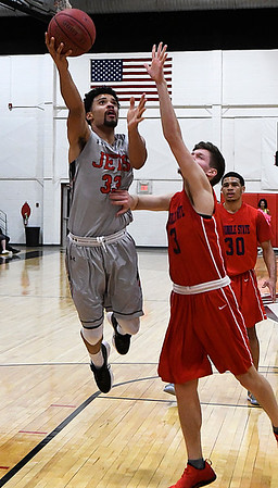 NOC Enid's Tony Hall puts up a shot against Seminole State's Camerson Kennedy Thursday January 25, 2018 at the NOC Mabee Center. (Billy Hefton / Enid News & Eagle)