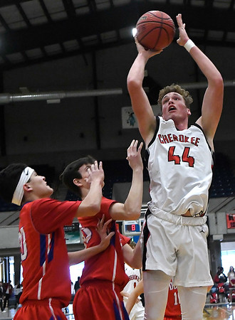 Cherokee's Blake Hall shoots over DCLA's Palladin Compala and Colby Smith during the first round of the Cherokee Strip Conference Tournament Thursday January 24, 2019 at the Chisholm Trail Expo Center. (Billy Hefton / Enid News & Eagle)