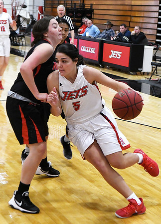 NOC Enid's Addi Meeker drives the baseline against Mid American's Rebekah Wilson Monday January 7, 2019 at the NOC Mabee Center. (Billy Hefton / Enid News & Eagle)