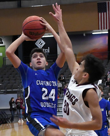 Covington-Douglas' Christian Tarango puts up a shot in the lane against Pioneer's Kevin Noel during the first round of the Skeltur Conference Tournament Thursday January 24, 2019 at the Central National Bank Center. (Billy Hefton / Enid News & Eagle)