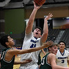 Hennessey's Mitchel Mirkes puts up a shot between Thomas' Zach Selzer and Ethan Hamberlin during the first round of the Three Rivers Tournament Thursday January 10, 2019 at the Central National Bank Center. (Billy Hefton / Enid News & Eagle)