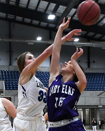 Lomega's Emma Duffy blocks the shot of Burlington's Savannah Granados during the championship game of the Cherokee Strip Conference Tournament Saturday january 26, 2019. (Billy Hefton / Enid News & Eagle)