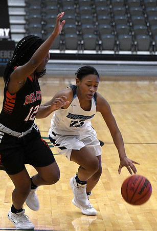 Enid's Bree Mya Edwards drives towards the basket against Del City's Aliyah Dean Tuesday January 22, 2018 at the Central National Bank Center. (Billy Hefton / Enid News & Eagle)