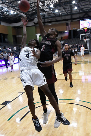 Enid's Carlos Mennefield puts up a shot against Putnam City North's Jeff Nwankwo Tuesday january 29, 2019 at the Central national Bank Center. (Billy Hefton / Enid News & Eagle)
