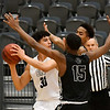 Enid's Cyson Mathis gets trapped by Del City's Jack Foreman and Keyondre Young Tuesday January 22, 2018 at the Central National Bank Center. (Billy Hefton / Enid News & Eagle)