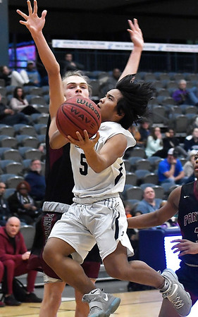 Enid's Jadon Dimarucut drives to the basket against Putnam City North's Ryan Miller Tuesday january 29, 2019 at the Central national Bank Center. (Billy Hefton / Enid News & Eagle)
