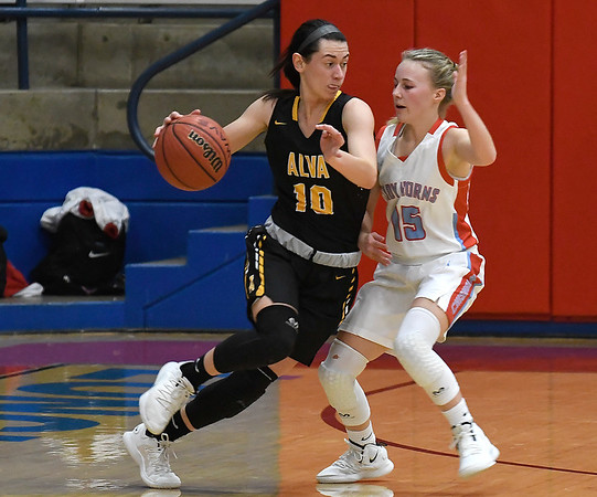 Chisholm's Regi Pasby pressures Alva's Hallie Durkee during the first round of the Wheat Capital Tournament Thursday January 10, 2019 at Chisholm High School. (Billy Hefton / Enid News & Eagle)