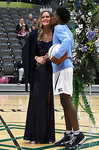 Enid High School's basketball homecoming king, Carlos Menefield gives a kiss to queen Cayti Moeller Friday January 18, 2019 at the Central National Bank Center. (Billy Hefton / Enid News & Eagle)