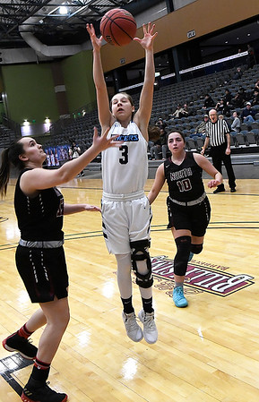 Enid's Ashley Handing grabs a rebound in front of Putnam City North's Mara Yocham Tuesday january 29, 2019 at the Central national Bank Center. (Billy Hefton / Enid News & Eagle)
