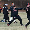 Members od the NOC Enid baseball team warm-up prior to practice at Failing Field Thursday January 31, 2019. (Billy Hefton / Enid News & Eagle)