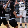 Enid's Catyi Moeller shoots over Putnam City North's Reagan Hollowell and Jayda Garrison Tuesday january 29, 2019 at the Central national Bank Center. (Billy Hefton / Enid News & Eagle)