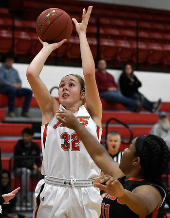 NOC Enid's Sarah Griswold shoots over Mid American's Jaidan Alley Monday January 7, 2019 at the NOC Mabee Center. (Billy Hefton / Enid News & Eagle)