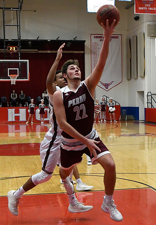 Perry's Mason Drake gets by Holland Hall's Brock Davis for a basket during the championship game of the Wheat Capital Tournament Saturday January 12, 2019 at Chisholm High School. (Billy Hefton / Enid News & Eagle)