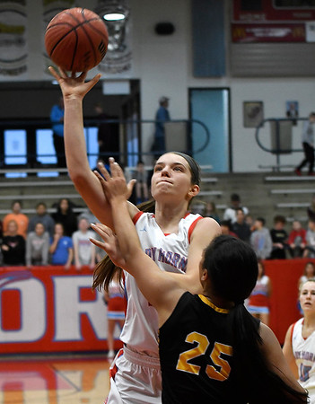 Chisholm's Jessica Corey shoots over Alva's Acacia Charles during the first round of the Wheat Capital Tournament Thursday January 10, 2019 at Chisholm High School. (Billy Hefton / Enid News & Eagle)