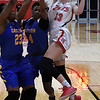 NOC Enid's Kaylee Hurst drives to the basket against Eastern Oklahoma's Shaian James and Deborrah Crutchfield Thursday January 24, 2019 at the NOC Mabee center. (Billy Hefton / Enid Nws & Eagle)